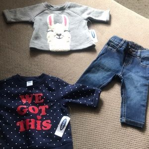 Two brand new baby sweaters, a pair of blue jeans